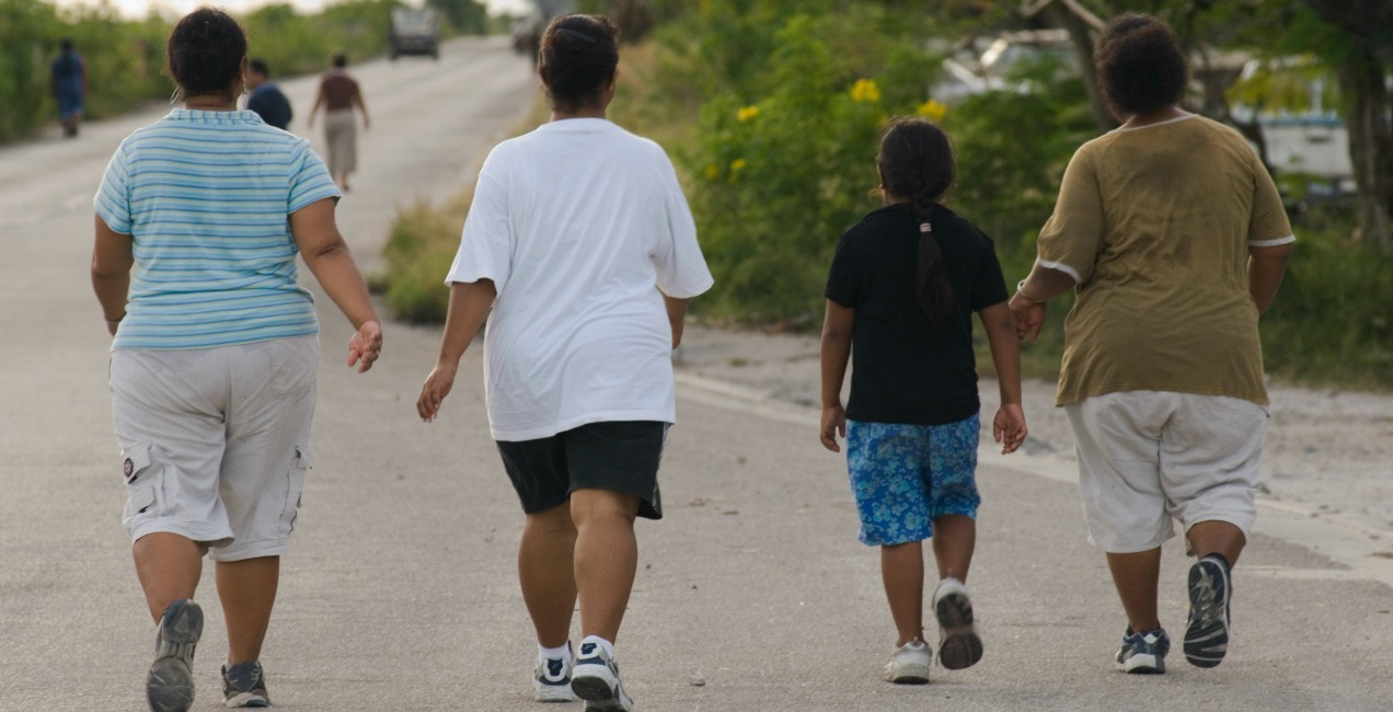 CAPTION : Members of health walk around Nauru airport.
